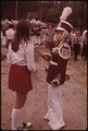 CHEERLEADER CHATS WITH HIGH SCHOOL BAND LEADER BEFORE MEMORIAL DAY PARADE AT THE LITTLE TOWN OF INLET NEAR THE FULTON... - NARA - 554451.tif