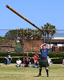 Man throwing the caber, a tapered pole.