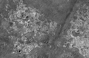 Valley network - Finer scale valley networks near Candor Chasma, seen by HiRISE (click to zoom). Field of view is roughly 3.5 km across. Surface the valleys are cut into appears to be eroding back.
