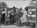 Centerville, California. Members of farm family board evacuation bus. Evacuees of Japanese ancestr . . . - NARA - 537584.tif