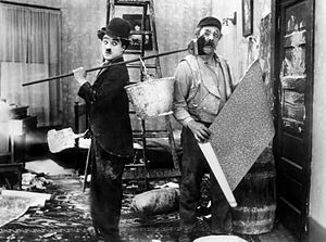 Slapstick - A slapstick scene from the 1915 Charlie Chaplin film His New Job. Chaplin started his film career as a physical comedian and his later work continued to contain elements of slapstick.