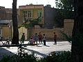 Children playing with water in 17 Shahrivar street rill - Nishapur 2.JPG