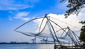 Chinese fishing nets with blue cloudy sky in the background
