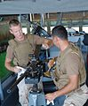 Coast Guard seamen maintain their weapons.jpg
