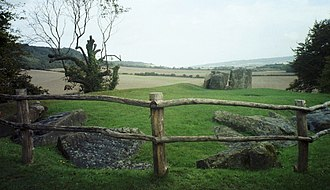 Megalithic architectural elements - Although the barrow mound is now almost gone, the surrounding peristalith at Coldrum Stones in Kent still survives (foreground). The stone burial chamber can be seen in the background.