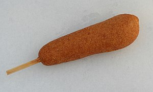 English: A hand-dipped corn dog on a stick, se...
