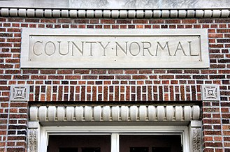"Normal school - ""County Normal"" above an entrance to the normal school in Viroqua, Wisconsin"