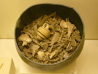Cremation - Bronze container of ancient cremated human remains, complete with votive offering