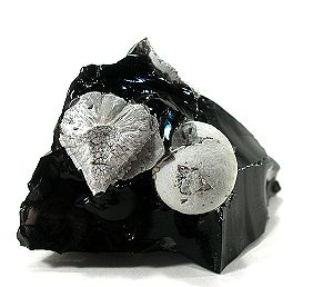 Cristobalite - Cristobalite spheres formed by devitrification from the obsidian matrix (California, USA) 5.9×3.8×3.8 cm