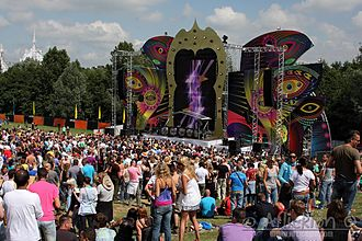 Music venue - The annual Dance Valley dance music festival in the Netherlands. Such music festivals typically include a large temporary stage, are held outdoors, and include other attractions such as food, performance art and other social activities.