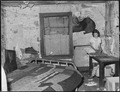Daughter of Gillie Treadway, a miner, in one of the room of the four room house for which they pay $5.25 monthly... - NARA - 541159.tif