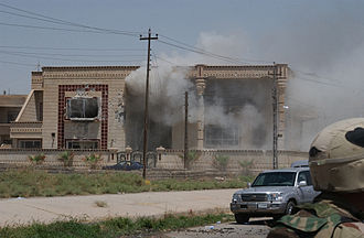 2003 Mosul raid - Smoke pours from Uday and Qusay Hussein's safehouse during the raid after it was hit by a TOW missile