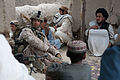 Defense.gov News Photo 110504-M-QZ858-039 - U.S. Marine Corps Sgt. Christan A. Marlow left with Bravo Company 1st Battalion 5th Marine Regiment Regimental Combat Team 8 talks to Afghan.jpg