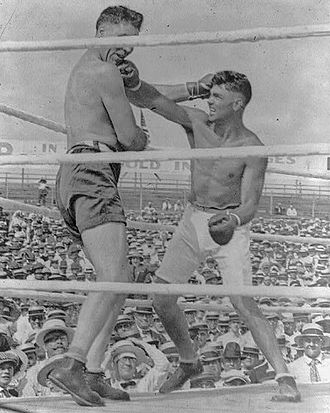 Jess Willard - Willard (left) taking a punch to the chin from Jack Dempsey (right).