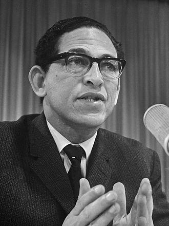 Dennis Brutus - Dennis Brutus during a press conference at Schiphol Airport, 1967