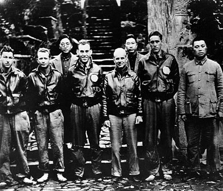 Lt. Col. Doolittle with members of his flight crew and Chinese officials in China after the attack. From left to right: Staff Sgt. Fred A. Braemer, bombardier; Staff Sgt. Paul J. Leonard, flight engineer/gunner; Chao Foo Ki, secretary of the Western Chekiang Province Branch Government. 1st Lt. Richard E. Cole, copilot; Doolittle; Henry H. Shen, bank manager; Lt. Henry A. Potter, navigator; General Ho, director of the Branch Government of Western Chekiang Province; DoolittleRaiders China h97502.jpg