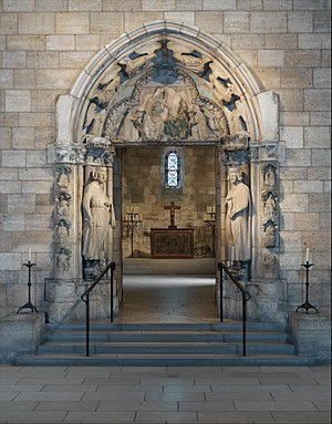 Doorway from Moutiers-Saint-Jean - Doorway, French, c. 1250. 185 × 55 inches at its widest points. The apse of the Langon Chapel is in the background