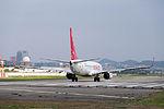 Eastar Jet B737-86J HL8264 Stand by at Taipei Songshan Airport Runway 20150101.jpg