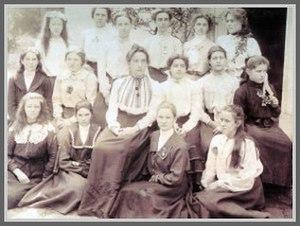 Edith Aitken - Ms. Edith Aitken with pupils in 1903