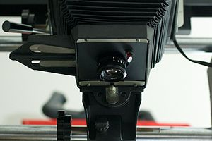 Enlarger - Enlarger lens: using the diaphragm - aperture ring the photographer adjusts the iris.