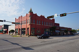 Ennis, Texas - The Emporium Building at the intersection of Ennis Avenue and Dallas St. in Downtown Ennis.