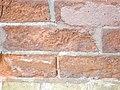 Eroded bricks sw corner of front and frederick, 2013 02 18 -bd.JPG - panoramio.jpg