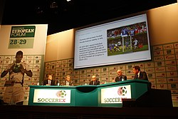 A conference between the organizations of UEFA and Soccerex taking place.