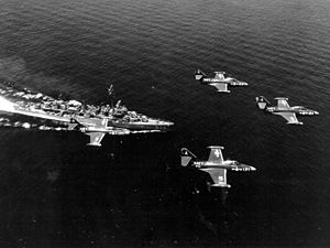 USS Tingey (DD-539) - F9F-2Bs flying over Tingey off Korea, in 1951.