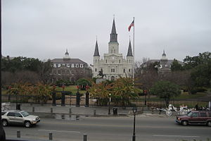 The Presbytere - View of Jackson Square. The Cathedral is the central building, with the Cabildo to the left and the Presbytere to the right.