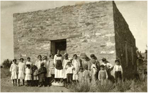 Fabiola Cabeza de Baca Gilbert - Fabiola Cabeza de Baca in front of a rural school in New Mexico, circa 1920s.