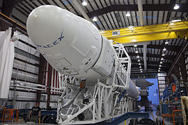 Falcon 9 in SLC-40 hangar before roll-out - CRS-2 (KSC-2013-1676).jpg