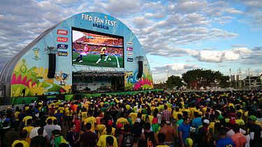 An association football match being watched by a large audience. Fan fest Brasilia.jpg