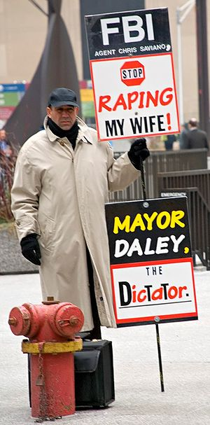 Farhad Khoiee-Abbasi - Farhad Khoiee-Abbasi protests in Chicago's Daley Plaza, across the street from City Hall.
