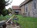 Farm implements in St Mary's churchyard, Barnham - geograph.org.uk - 598634.jpg