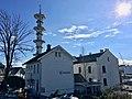 """Fengselet (""""The Prison"""") and restaurant in Jens Hystadvegen, Skrivarvegen in front, Radio tower (Telebygget) in Borggata 10 in the backgrund. Leirvik, Stord, Norway 2018-03-13 c.jpg"""