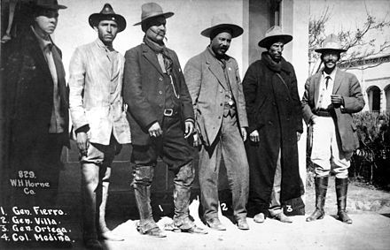 "Northern Revolutionary Gen. Francisco ""Pancho"" Villa with his staff in 1913. Villa is in gray suit in center. His aide, Gen. Rodolfo Fierro, is to Villa's right. Villa and Fierro served in the Constitutionalist Army opposing Huerta. Once Huerta was ousted in July 1914, Villa joined with Emiliano Zapata in the Army of the Convention and fought his former leader Venustiano Carranza and General Alvaro Obregón. Fierro Pancho Villa Ortega Medina.jpg"