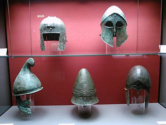 Corinthian helmet - Ancient Greek helmets. Top line, left to right: Illyrian type helmet, Corinthian helmet. Bottom line, left to right: Phrygian type helmet, Pilos, Chalcidian helmet. Staatliche Antikensammlungen