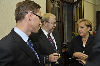 Mart Laar - Minister of finance of Finland Jyrki Katainen, Mart Laar and the chancellor of Germany, Angela Merkel in the EPP Summit of 2010