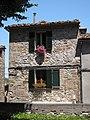 Flowers in Windows of Trequanda - panoramio.jpg