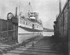 Flyer (steamboat) - Flyer in floating drydock at Quartermaster Harbor, on Maury Island, sometime before 1895