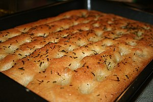 Focaccia - Focaccia al rosmarino prepared with fresh rosemary from a garden