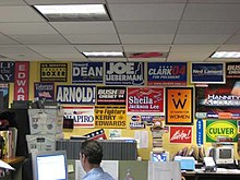 Newsroom, with political signs on the wall