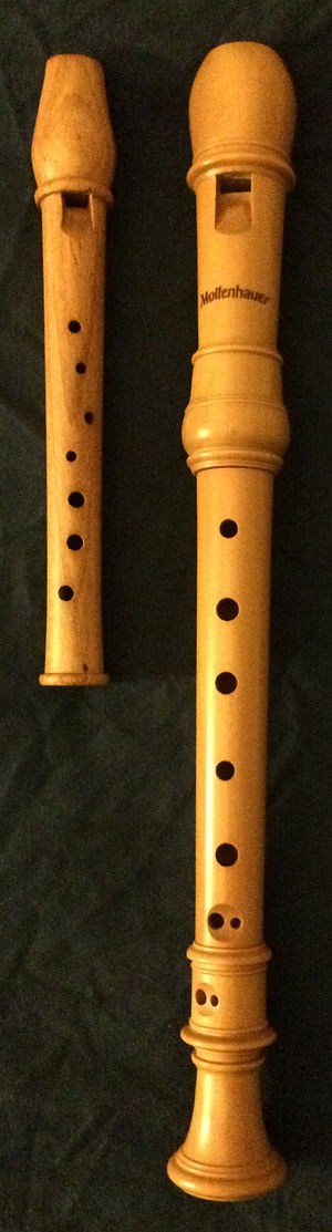 "Garklein recorder - A one-piece garklein recorder in plum wood, next to a three-piece soprano recorder in castello or zapatero ""boxwood"" for comparison."