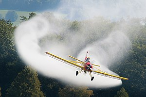 Aerial application - A PZL-106 Kruk crop duster applying a fine mist