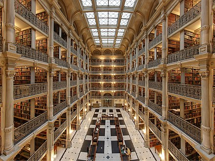 Interior of the George Peabody Library at the Peabody Institute of Johns Hopkins University. It is considered one of the most beautiful libraries in the world. George-peabody-library.jpg