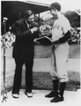 George Bush, captain of the Yale baseball team, receives Babe Ruth's manuscript of his autobiography which he was... - NARA - 186375.tif
