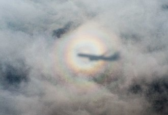 Brocken spectre - Shadow of an airplane cast by the sun on nearby clouds
