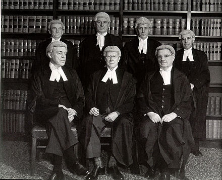The bench in 1952, shortly before Chief Justice Latham's retirement. Back, left to right, Fullagar, Webb, Williams & Kitto. Front, left to right, Dixon, Latham & McTiernan. HCA bench 1952.jpg
