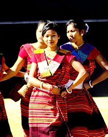 Hajong girls in rang'a pathin and phule' argon.jpg