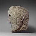 Head of a Man Wearing a Cap or Helmet MET DP136612.jpg